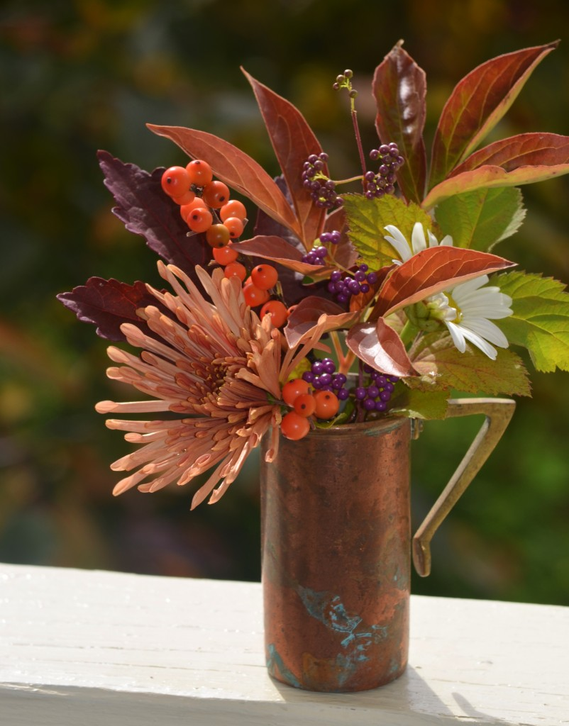wintergold holly calicarpa berries, montauk daisy, peach centerpiece mum. peony and red shield hibiscus leaves